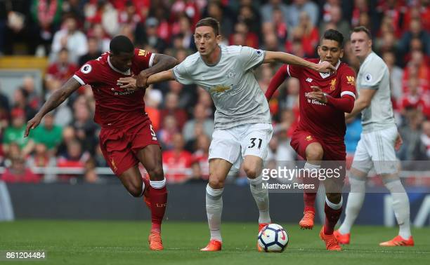 Nemanja Matic of Manchester United in action with Georgina Wijnaldum of Liverpool during the Premier League match between Liverpool and Manchester...