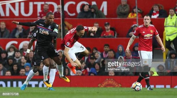 Nemanja Matic of Manchester United in action with Jason Puncheon of Crystal Palace during the Premier League match between Manchester United and...