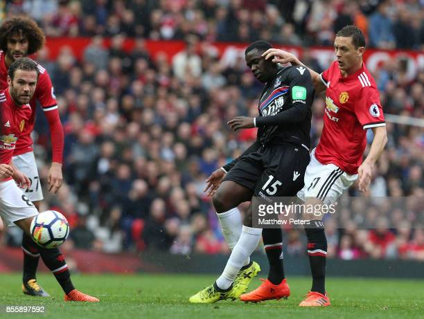 Nemanja Matic of Manchester United in action with Jeffrey Schlupp of Crystal Palace during the Premier League match between Manchester United and...