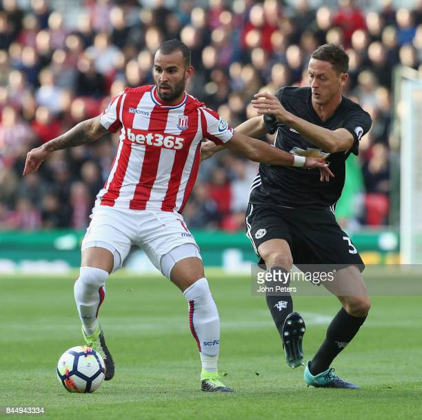 Nemanja Matic of Manchester United in action with Jese of Stoke City during the Premier League match between Stoke City and Manchester United at...