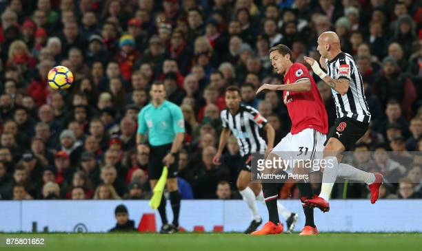 Nemanja Matic of Manchester United in action with Jonjo Shelvey of Newcastle United during the Premier League match between Manchester United and...