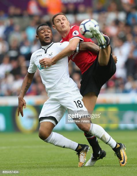 Nemanja Matic of Manchester United in action with Jordan Ayew of Swansea City during the Premier League match between Swansea City and Manchester...