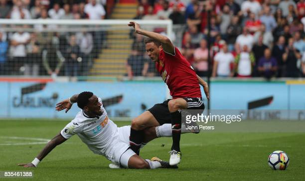 Nemanja Matic of Manchester United in action with Leroy Fer of Swansea City during the Premier League match between Swansea City and Manchester...