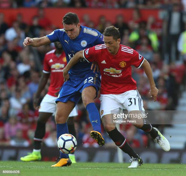 Nemanja Matic of Manchester United in action with Matty James of Leicester City during the Premier League match between Manchester United and...