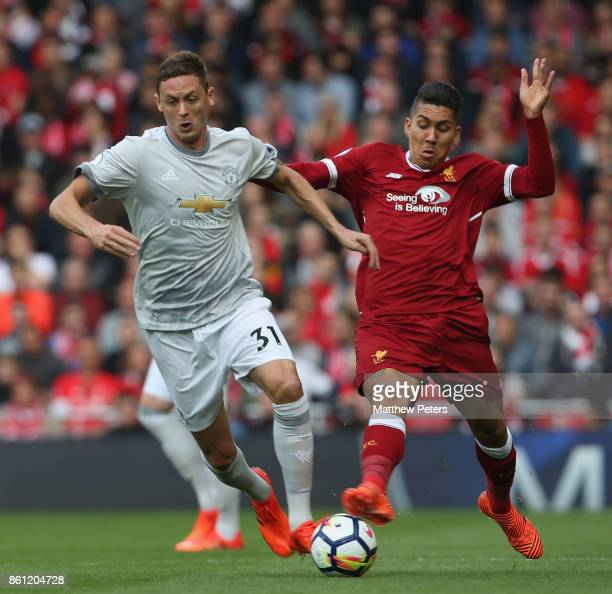 Nemanja Matic of Manchester United in action with Roberto Firmino of Liverpool during the Premier League match between Liverpool and Manchester...