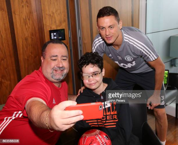 Nemanja Matic of Manchester United poses with Alex during a MU Foundation Dream Day at Aon Training Complex on October 20 2017 in Manchester England