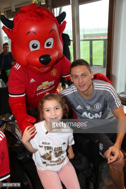 Nemanja Matic of Manchester United poses with Alice during a MU Foundation Dream Day at Aon Training Complex on October 20 2017 in Manchester England