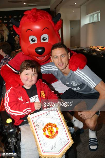 Nemanja Matic of Manchester United poses with Toby during a MU Foundation Dream Day at Aon Training Complex on October 20 2017 in Manchester England