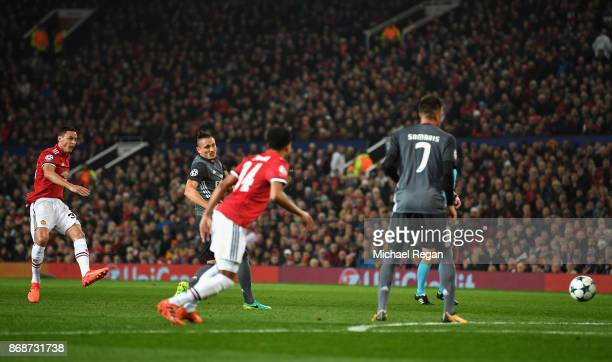 Nemanja Matic of Manchester United takes a shot leading to an own goal by Mile Svilar of Benfica during the UEFA Champions League group A match...