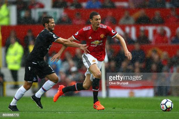 Nemanja Matic of Manchester United takes the ball past Yohan Cabaye of Crystal Palace during the Premier League match between Manchester United and...