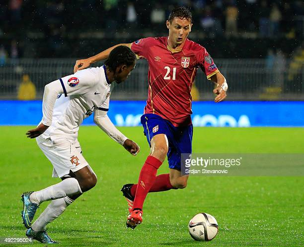 Nemanja Matic of Serbia in action against Nlson Semedo of Portugal during the Euro 2016 qualifying football match between Serbia and Portugal at the...