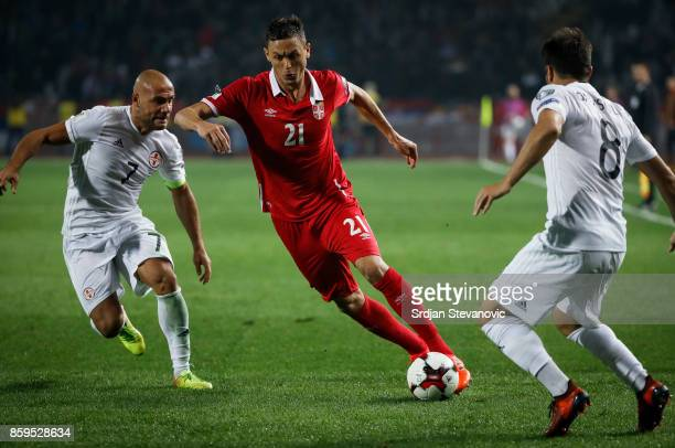 Nemanja Matic of Serbia in action against Valeri Kazaishvili and Jaba Kankava of Georgia during the FIFA 2018 World Cup Qualifier between Serbia and...