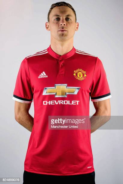 Nemanja Matic poses in a team shirt after signing for Manchester United at Aon Training Complex on July 31 2017 in Manchester England