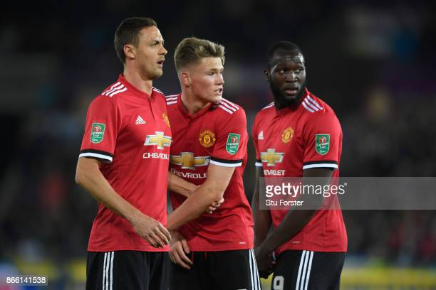 Nemanja Matic Scott McTominay and Romelu Lukaku of United in the defensive wall during the Carabao Cup Fourth Round match between Swansea City and...