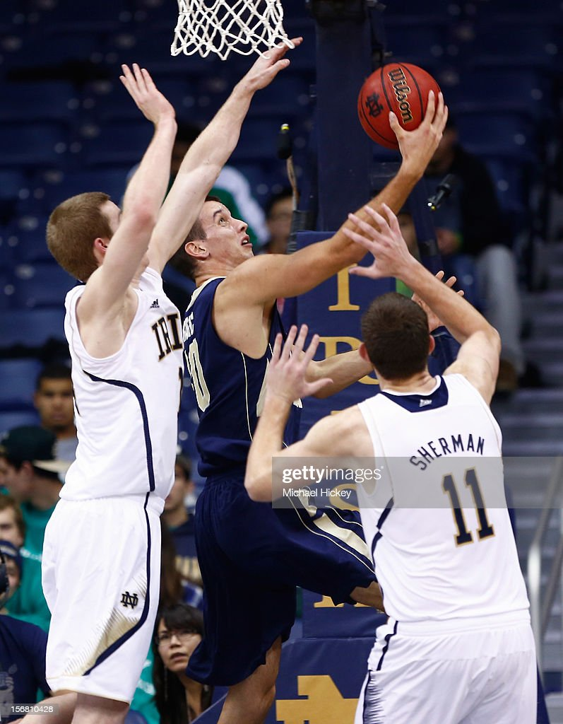 Nemanja Mikic #30 of the George Washington Colonials puts up a layup as <a gi-track='captionPersonalityLinkClicked' href=/galleries/search?phrase=Scott+Martin+-+Basketball+Player&family=editorial&specificpeople=15168896 ng-click='$event.stopPropagation()'>Scott Martin</a> #14 of the Notre Dame Fighting Irish and Garrick Sherman #11 of the Notre Dame Fighting Irish defend at Purcel Pavilion on November 21, 2012 in South Bend, Indiana. Notre Dame defeated George Washington 65-48.