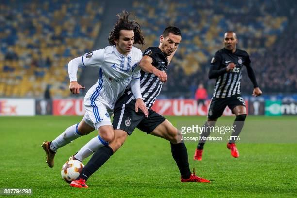 Nemanja Miletic of FK Partizan Belgrade tackles Mykola Shaparenko of FC Dynamo Kyiv during the UEFA Europa League group B match between FC Dynamo...