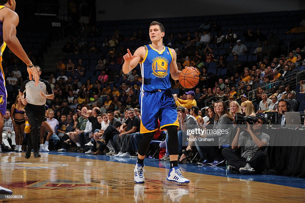 Nemanja Nedovic #8 of the Golden State Warriors brings the ball up the floor against the Los Angeles Lakers at Citizens Business Bank Arena on October 5, 2013 in Ontario, California.
