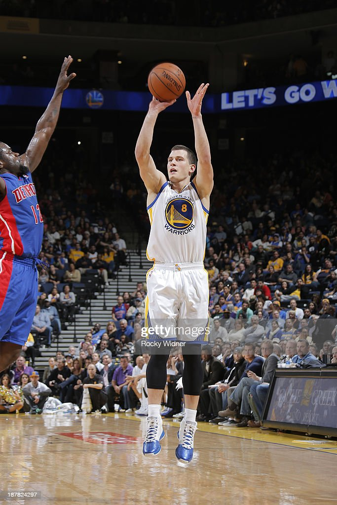 Nemanja Nedovic #8 of the Golden State Warriors shoots against <a gi-track='captionPersonalityLinkClicked' href=/galleries/search?phrase=Will+Bynum&family=editorial&specificpeople=212891 ng-click='$event.stopPropagation()'>Will Bynum</a> #12 of the Detroit Pistons on November 12, 2013 at Oracle Arena in Oakland, California.