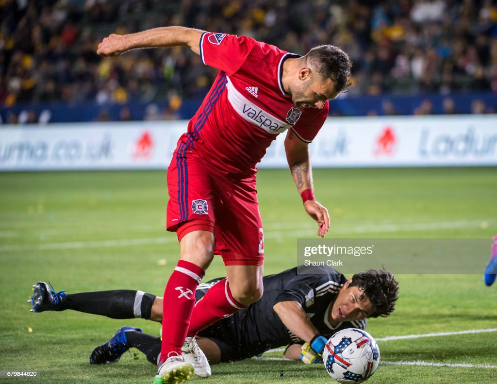 Nemanja Nikolic #23 of Chicago Fire gets past Brian Rowe #12 of Los Angeles Galaxy during Los Angeles Galaxy's MLS match against Chicago Fire at the StubHub Center on May 6, 2017 in Carson, California. The match ended in a 2-2 tie.
