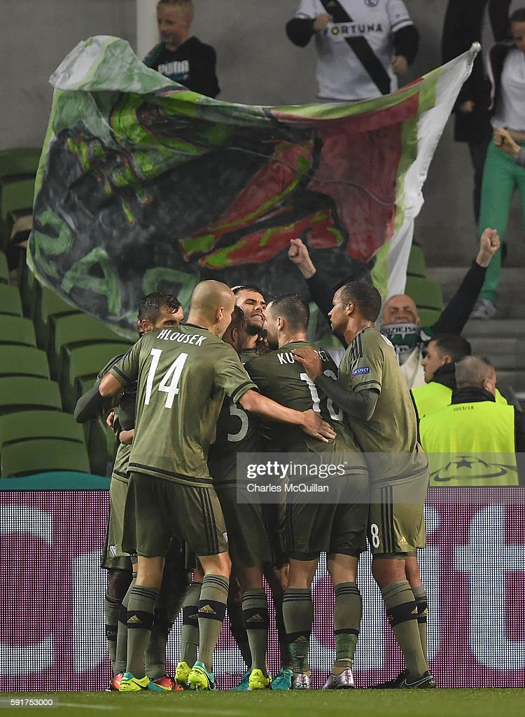 Nemanja Nikolic of Legia Warsaw celebrates with team mates after scoring a penalty during the Champions League qualifying round game between Dundalk...