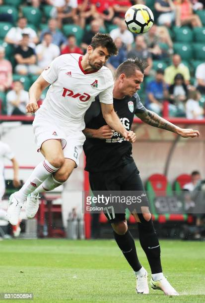 Nemanja Pejchinovich of FC Lokomotiv Moscow vies for the ball with Anton Zabolotny of FC Tosno Khabarovsk during the Russian Premier League match...