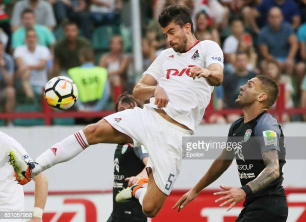 Nemanja Pejchinovich of FC Lokomotiv Moscow vies for the ball with Rade Dugalich of FC Tosno Khabarovsk during the Russian Premier League match...