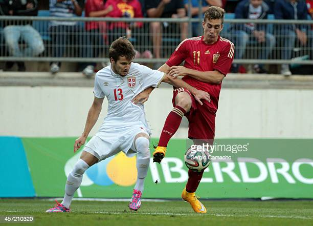 Nemanja Petrovic of Serbia duels for the ball with Gerard Deulofeu of Spain the 2015 UEFA European Under21 Championship playoff football match...
