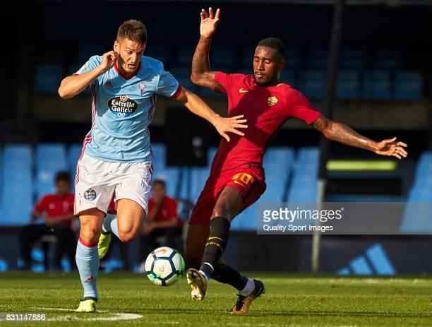 Nemanja Radoja of Celta de Vigo competes for the ball with Gerson Santos Da Silva of AS Roma during the preseason friendly match between Celta de...