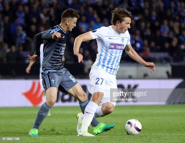 Nemanja Radoja of Celta Vigo in action against Sander Berge during the UEFA Europa League quarter final second leg match between KRC Genk and Celta...