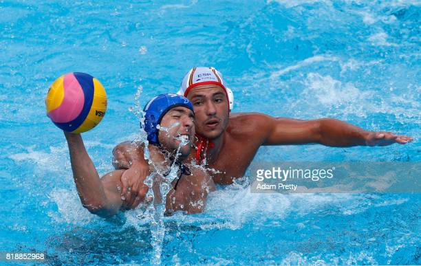 Nemanja Ubovic of Serbia is challenged during the Men's Water Polo Group C preliminary match between Spain and Serbia on day six of the Budapest 2017...