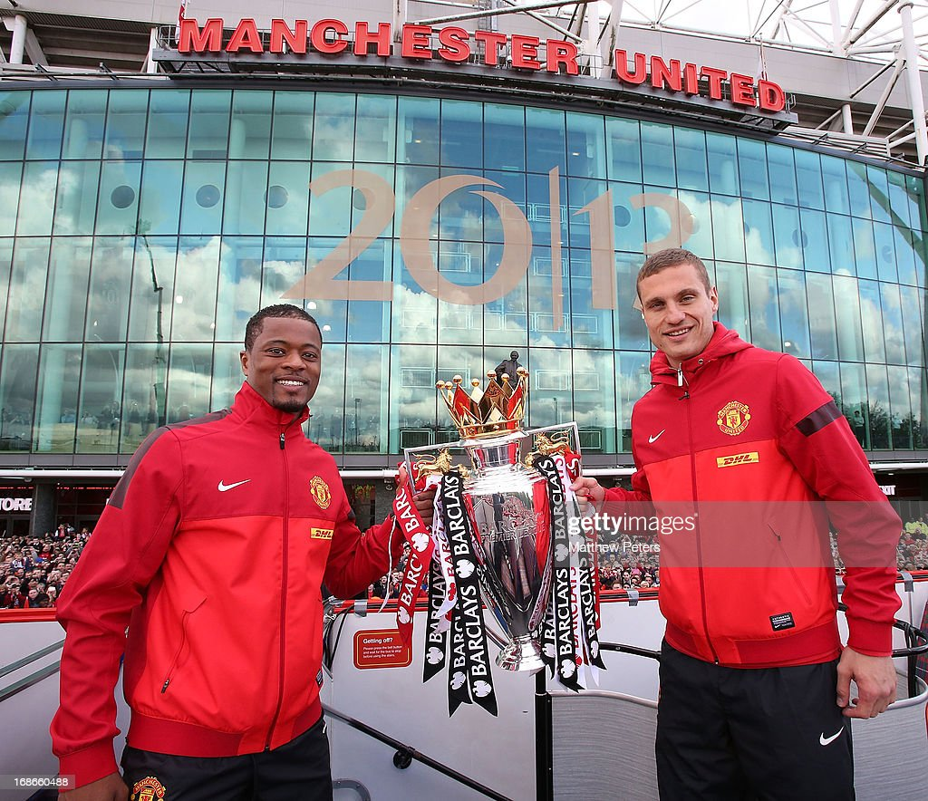 Nemanja Vidic and Patrice Evra of Manchester United pose with the Premier League trophy at the start of the Premier League trophy winners parade on May 13, 2013 in Manchester, England.