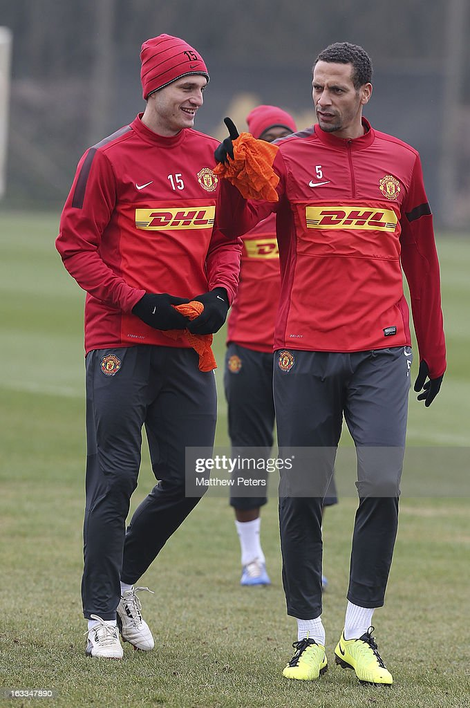 Nemanja Vidic and Rio Ferdinand of Manchester United in action during a first team training session at Carrington Training Ground on March 8, 2013 in Manchester, England.