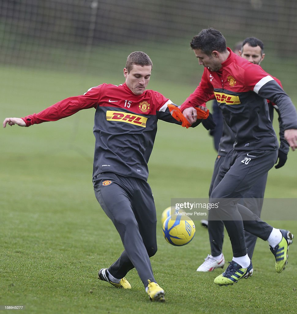 Nemanja Vidic (L) and Robin van Persie of Manchester United in action during a first team training session at Carrington Training Ground on January 4, 2013 in Manchester, England.