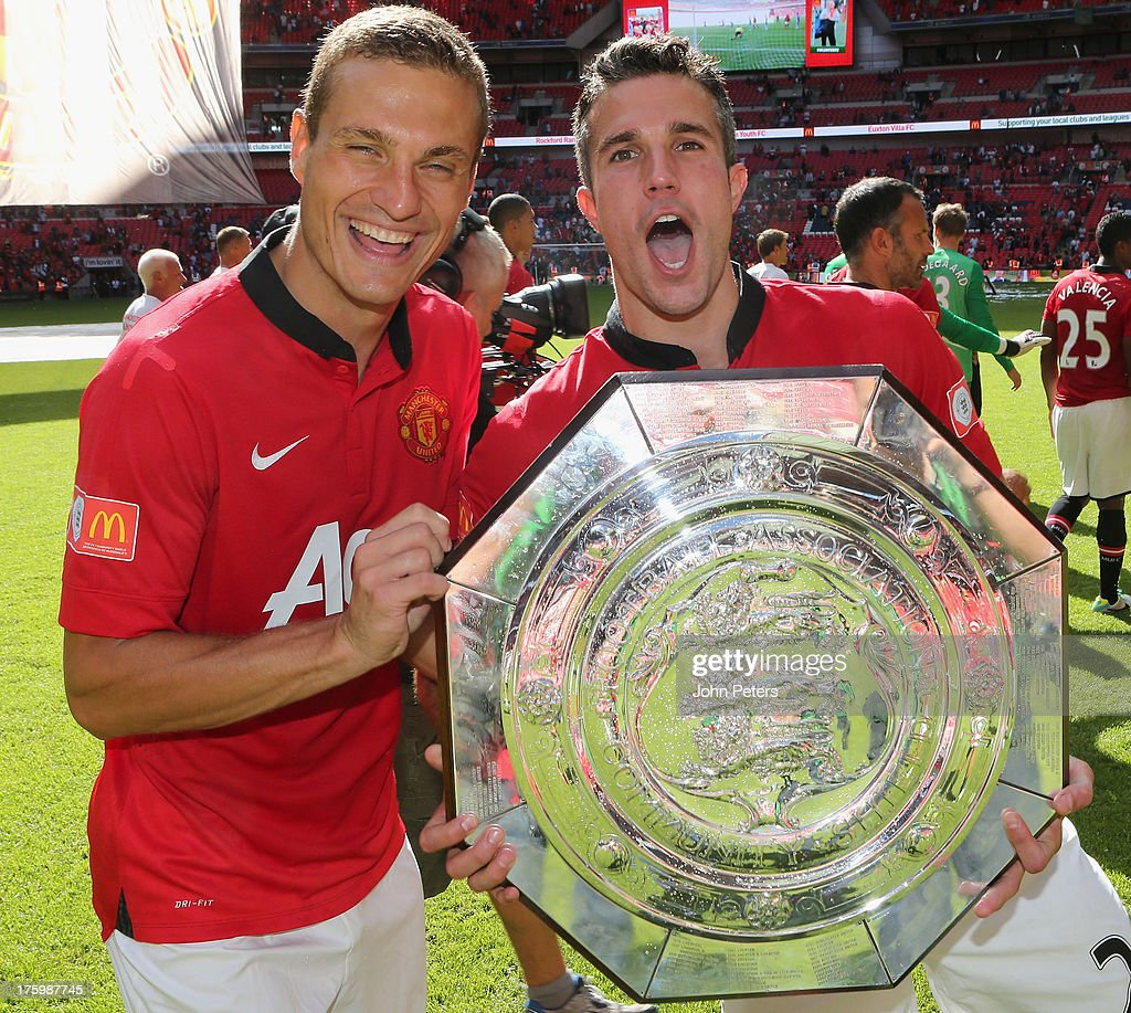 <a gi-track='captionPersonalityLinkClicked' href=/galleries/search?phrase=Nemanja+Vidic&family=editorial&specificpeople=497253 ng-click='$event.stopPropagation()'>Nemanja Vidic</a> and Robin van Persie of Manchester United pose with the FA Community Shield trophy after the FA Community Shield match between Manchester United and Wigan Athletic at Wembley Stadium on August 11, 2013 in London, England.