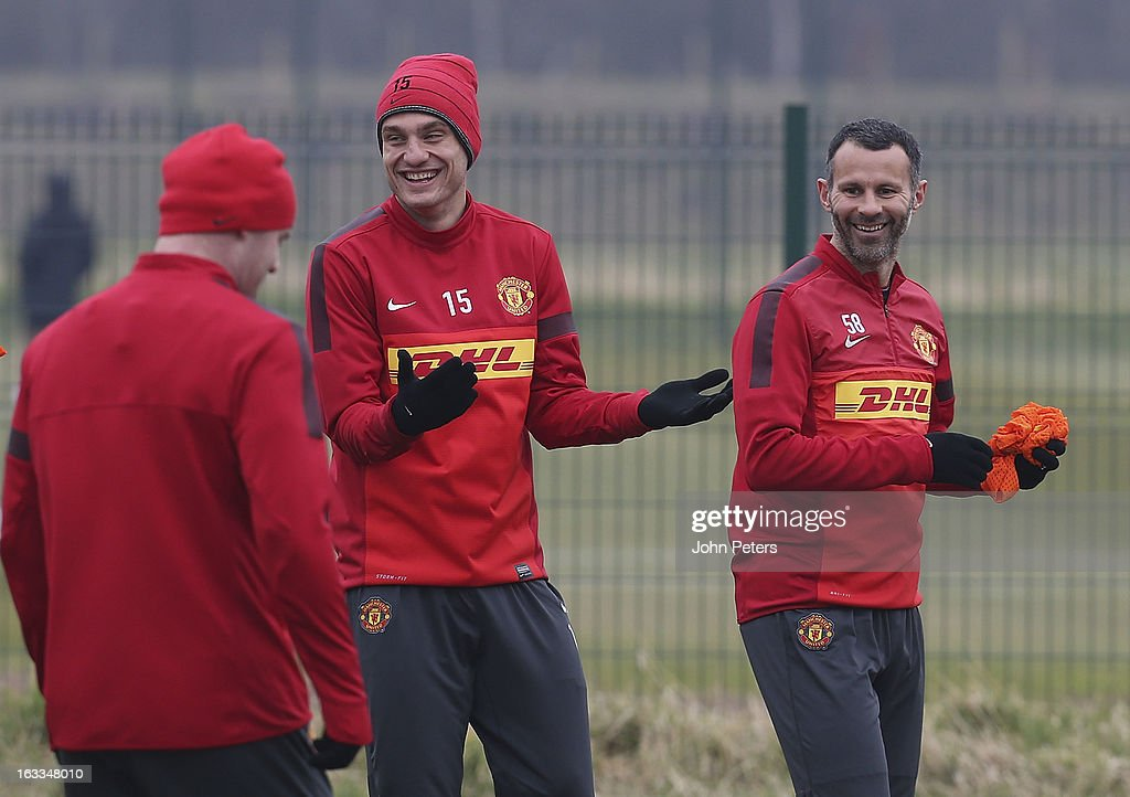 Nemanja Vidic (L) and Ryan Giggs of Manchester United in action during a first team training session at Carrington Training Ground on March 8, 2013 in Manchester, England.
