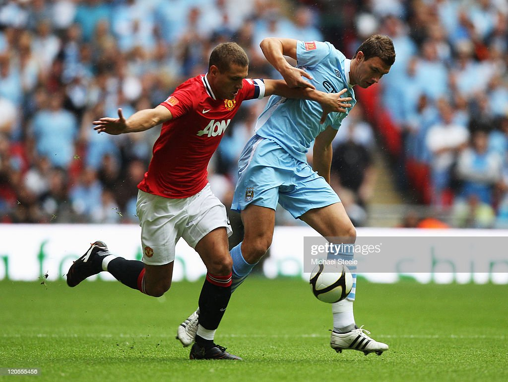 Nemanja Vidic of Manchester United and Edin Dzeko of Manchester City battle for the ball during the FA Community Shield match sponsored by McDonald's between Manchester City and Manchester United at Wembley Stadium on August 7, 2011 in London, England.