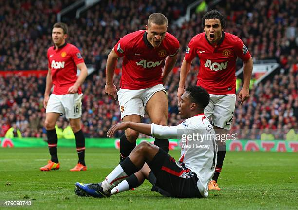 Nemanja Vidic of Manchester United and Rafael react to Daniel Sturridge of Liverpool after the award of the second penalty kick during the Barclays...