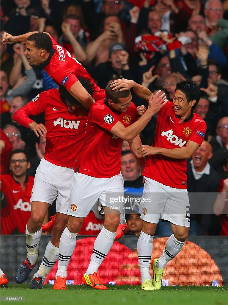 Nemanja Vidic of Manchester United celebrates with Shinji Kagawa of Manchester United after scoring their first goal during the UEFA Champions League Quarter Final first leg match between Manchester United and FC Bayern Muenchen at Old Trafford on April 1, 2014 in Manchester, England.