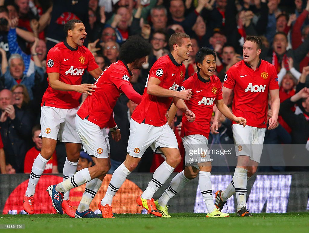 <a gi-track='captionPersonalityLinkClicked' href=/galleries/search?phrase=Nemanja+Vidic&family=editorial&specificpeople=497253 ng-click='$event.stopPropagation()'>Nemanja Vidic</a> of Manchester United celebrates with team mates after scoring their first goal during the UEFA Champions League Quarter Final first leg match between Manchester United and FC Bayern Muenchen at Old Trafford on April 1, 2014 in Manchester, England.
