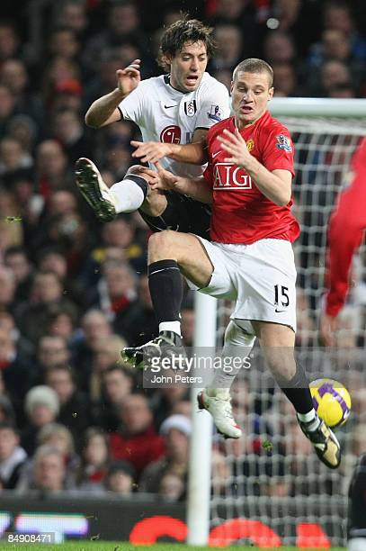 Nemanja Vidic of Manchester United clashes with Simon Davies of Fulham during the Barclays Premier League match between Manchester United and Fulham...
