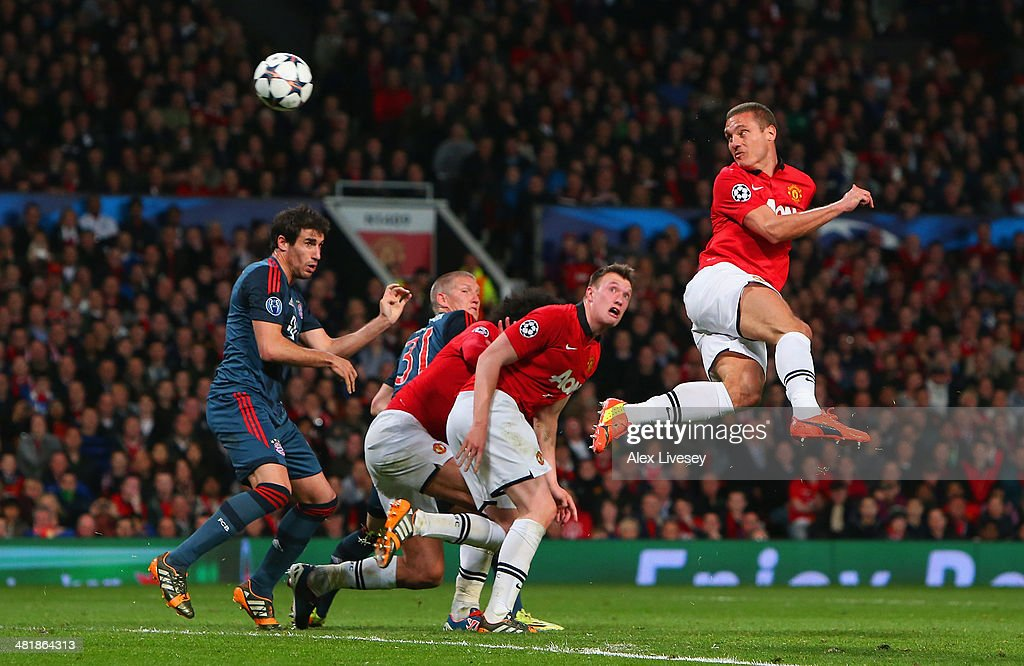 Nemanja Vidic of Manchester United heads in the first goal during the UEFA Champions League Quarter Final first leg match between Manchester United and FC Bayern Muenchen at Old Trafford on April 1, 2014 in Manchester, England.