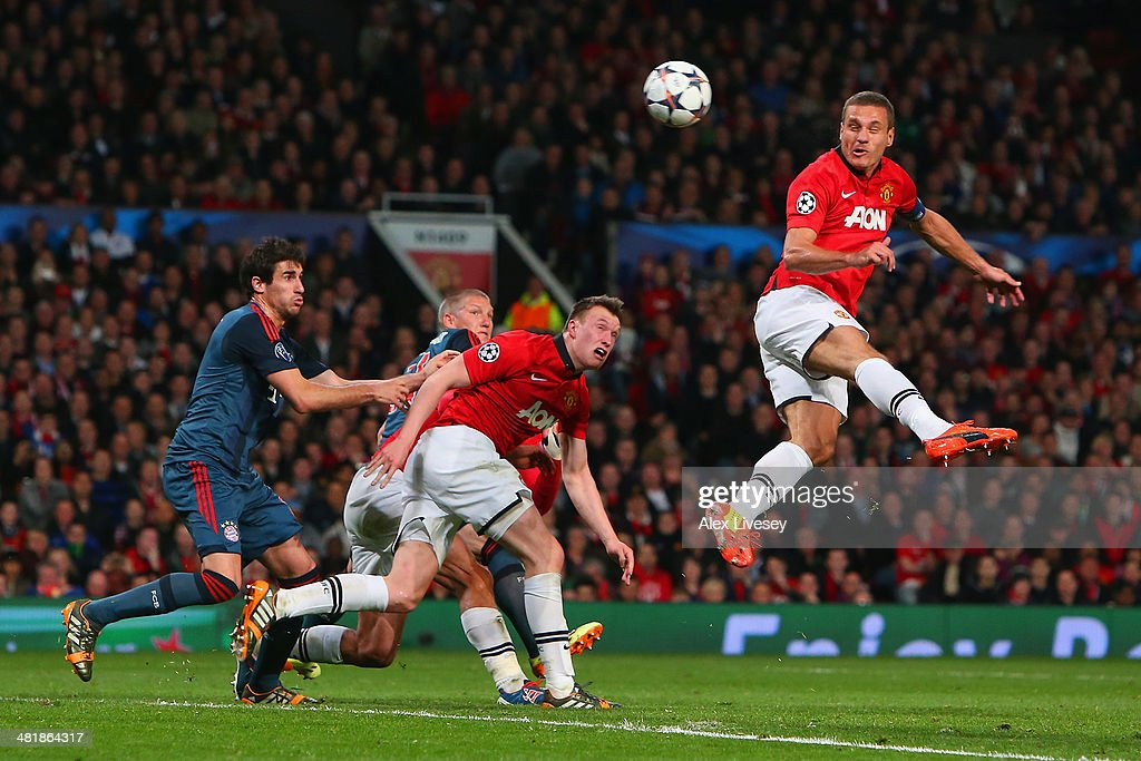 <a gi-track='captionPersonalityLinkClicked' href=/galleries/search?phrase=Nemanja+Vidic&family=editorial&specificpeople=497253 ng-click='$event.stopPropagation()'>Nemanja Vidic</a> of Manchester United heads in the first goal during the UEFA Champions League Quarter Final first leg match between Manchester United and FC Bayern Muenchen at Old Trafford on April 1, 2014 in Manchester, England.