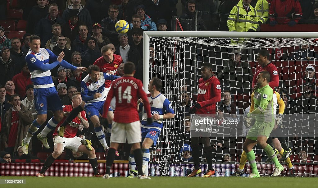 Nemanja Vidic of Manchester United in action with Adam Le Fondre of Reading during the FA Cup Fifth Round match between Manchester United and Reading at Old Trafford on February 18, 2013 in Manchester, England.