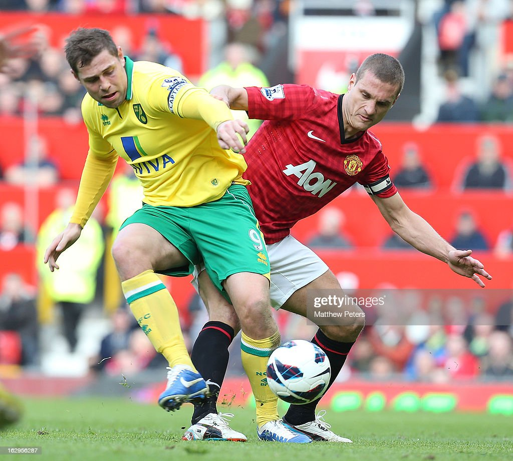 <a gi-track='captionPersonalityLinkClicked' href=/galleries/search?phrase=Nemanja+Vidic&family=editorial&specificpeople=497253 ng-click='$event.stopPropagation()'>Nemanja Vidic</a> of Manchester United in action with <a gi-track='captionPersonalityLinkClicked' href=/galleries/search?phrase=Grant+Holt&family=editorial&specificpeople=2091078 ng-click='$event.stopPropagation()'>Grant Holt</a> of Norwich City during the Barclays Premier League match between Manchester United and Norwich City at Old Trafford on March 2, 2013 in Manchester, England.