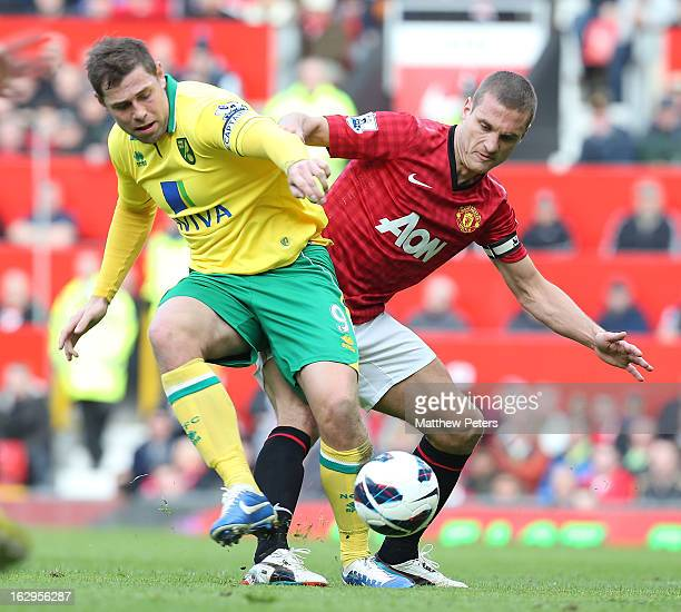 Nemanja Vidic of Manchester United in action with Grant Holt of Norwich City during the Barclays Premier League match between Manchester United and...