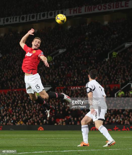 Nemanja Vidic of Manchester United in action with Jordi Amat of Swansea City during the Barclays Premier League match between Manchester United and...