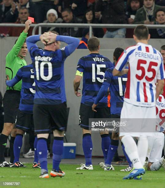 Nemanja Vidic of Manchester United is sent off by referee Felix Brych during the UEFA Champions League Group C match between Otelul Galati and...
