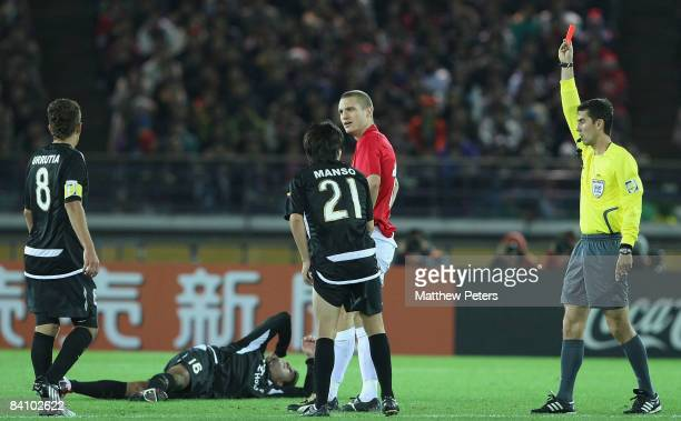 Nemanja Vidic of Manchester United is sent off by referee Ravshan Irmatov during the FIFA World Club Cup Final match between LDU Quito and Manchester...