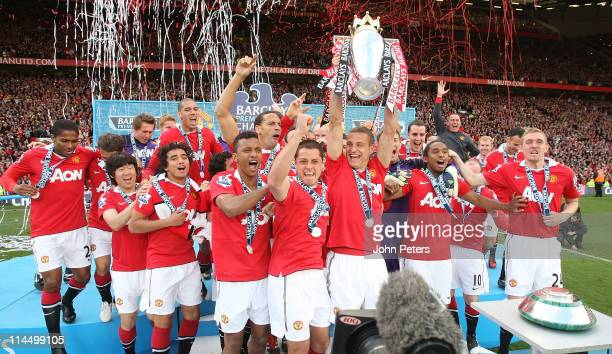 Nemanja Vidic of Manchester United lifts the Barclays Premier League trophy after the Barclays Premier League match between Manchester United and...