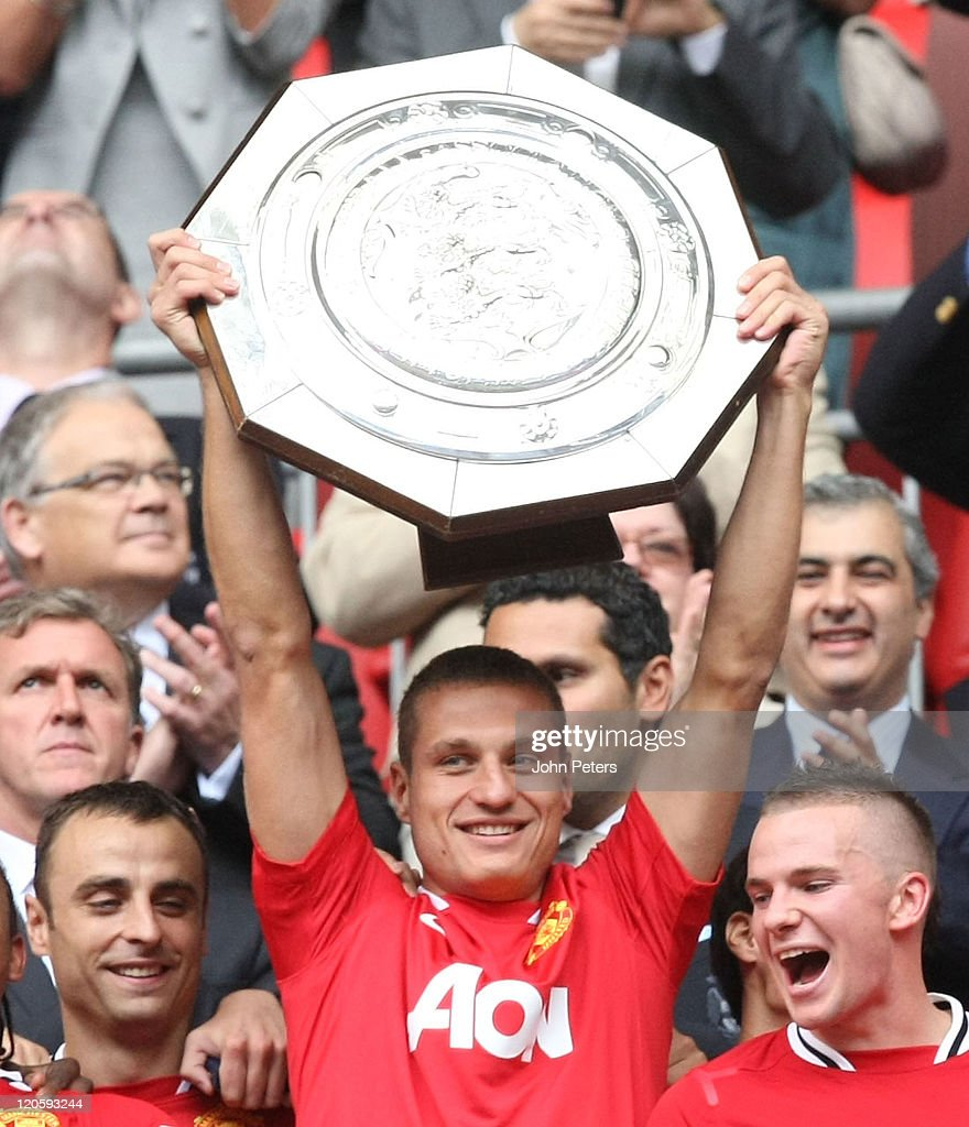 Nemanja Vidic of Manchester United lifts the Community Shield trophy after the FA Community Shield match between Manchester City and Manchester United at Wembley Stadium on August 7, 2011 in London, England.